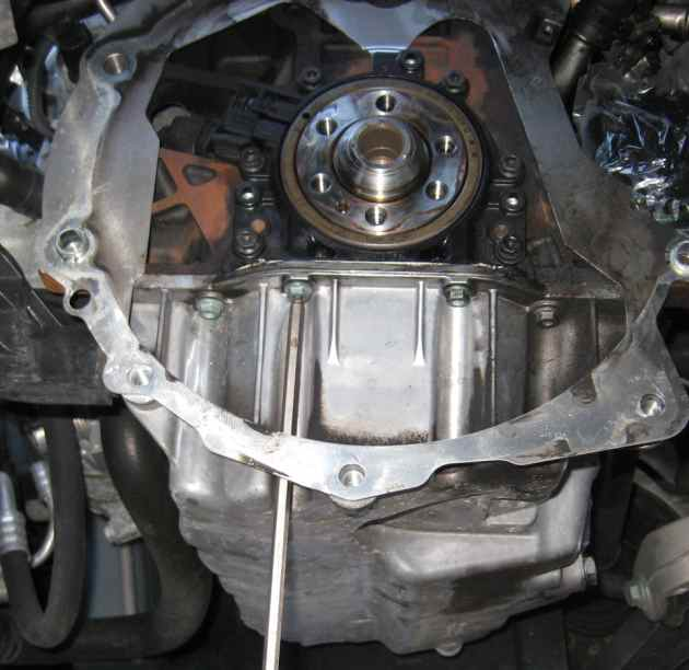 Rear main oil seal (engine speed sensor) replacement on a